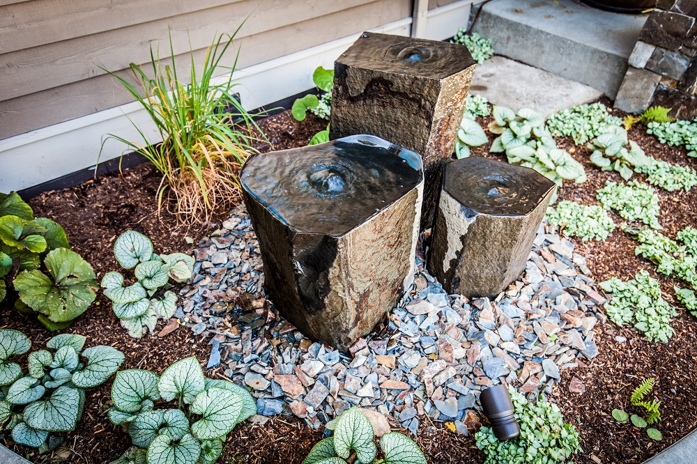 Landscape water feature at entrance to home