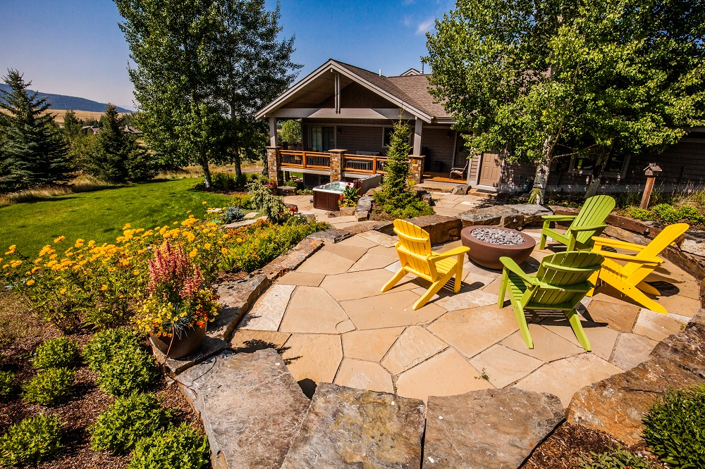Backyard patio and fire pit designed by Blanchford Landscape in Bozeman, MT