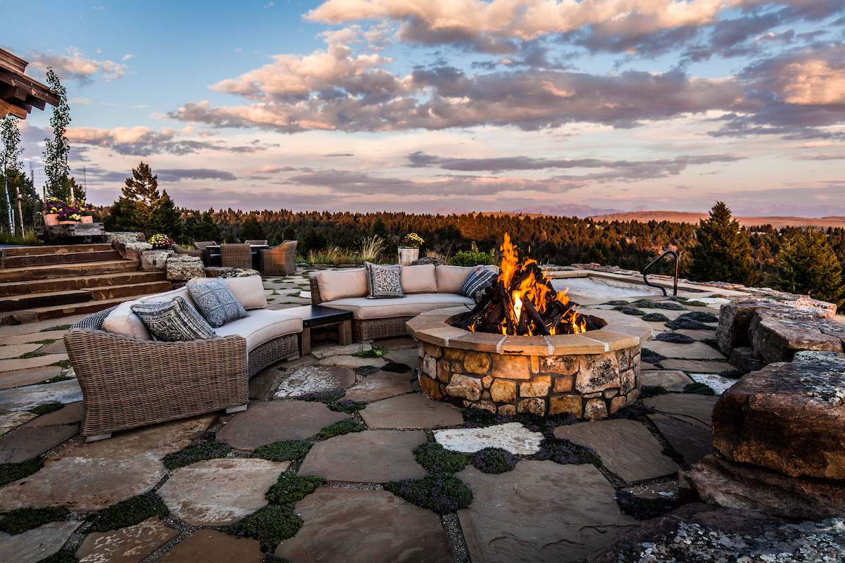 Fire pit and patio seating looking over mountains in Bozeman, MT
