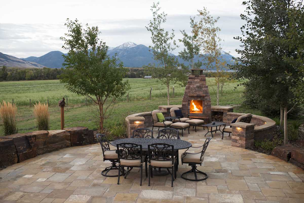 patio built with natural stone and fire feature