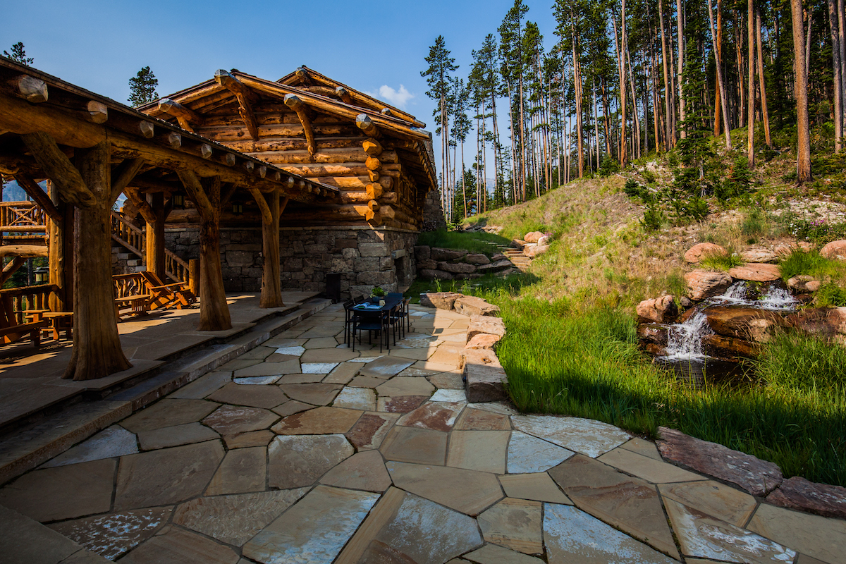beautiful patio with natural stone and waterfall